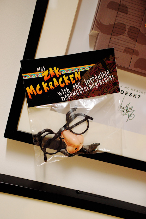 """Play Zack McKracken with the incredible nose mustache glasses!"" von Desk7 @ We Love 8-Bit Ausstellung Wien"